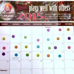 A 2015 calendar with happy-face stickers on the first 23 days of the year