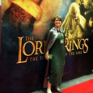 Indie author Stephanie A. Cain poses in a green and silver costume at GenCon