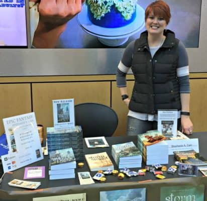 Self-publishing panelist Stephanie A. Cain stands at her table at the Allen County Public Library 2016 Author Fair