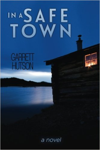 "Cover of mystery novel ""In a Safe Town"" by Garrett Hutson, this features a lake and a cabin under a cloudy sky"