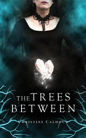 The Trees Between by Christine Calhoun; a woman wearing black stands with her hands cupped, holding small glowing orbs